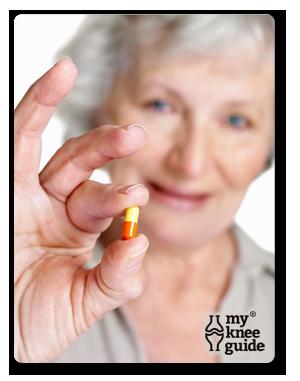 Arthritis patient holding pill
